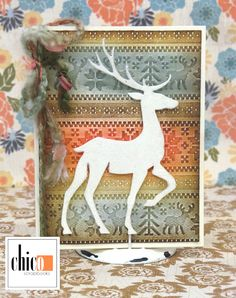 Tim Holtz Prancing Deer die and Knit set embossing folder by Sizzix.  A fun Make n Take card for the season!