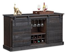 Uncork and Unwind. Display your wine in style with the rustic Ashcroft media credenza with wine storage. Featuring unique, sliding barn-door hardware and a distressed charcoal finish, this credenza includes a stemware rack, space for eight bottles of wine and storage for electronics or other collectibles. Ample space on top can be used to place your TV on or be used as a bar during gatherings with friends.