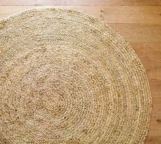 Hand-spun jute is braided, then wound and stitched in a spiral to form this sustainably harvested jute rug that highlights the fiber's natural color variations.      Crafted of sustainably harvested jute, a fast-growing, renewable natural fiber.     Handmade by artisan rug makers.     Fully reversible for twice the wear.