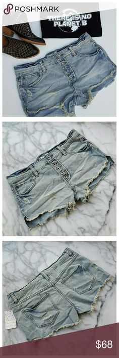 """Free People Runaway Slouchy Cutoffs - Fawm Distressed slouchy cutoff shorts with fringed hem and exposed button fly. Light wash, classic five-pocket styling. Width at waist 15.75"""", front rise 8.75"""", back rise 13"""", inseam 2.75"""". 100% cotton, machine wash/dry. Free People Shorts Jean Shorts"""