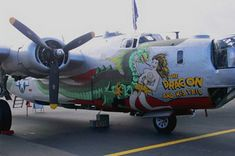 the dragon and his tail aircraft nose art