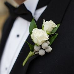 two white mini roses and babys breath boutonniere for frank without berries as pictured here