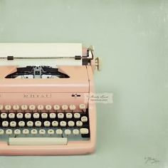 Vintage Typewriter.... Decoration in pale teal or other antique/ quirky accents (inside)... Could put note cards next to it for people to write to bride & groom?