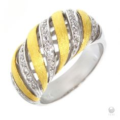- Exclusive FERI 950 Siledium silver  - Exclusive dual natural rhodium and palladium plating  - Set with exclusive FERI Swan cut lab stones  - Colour: two tone  - 3 micron 22 karat yellow plated gold  - Cocktail style ring    Invest with confidence in FERI Designer Lines.    www.feridesignerlines.com/nancymcleod | Shop this product here: spreesy.com/nancymcleod/44 | Shop all of our products at http://spreesy.com/nancymcleod    | Pinterest selling powered by Spreesy.com