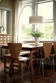 ..love the arch light over the dining table