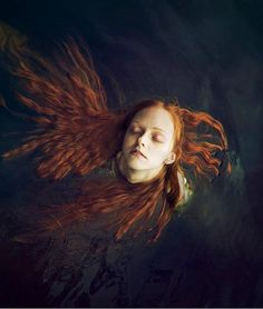 Red headed Woman in the water. by Celine.Excoffon, via Flickr