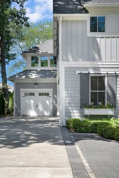 exterior paint color: Network Gray by Sherwin Williams; shutters: Peppercorn Sherwin Williams; trim:  Sherwin Williams SW 6252 Ice Cube.