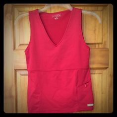 """Red Athleta tank Tank is in great condition.  The only sign of any wear is towards the bottom as shower in the picture.  The word """"Athleta"""" has faded. Other than that the top is perfect! Athleta Tops Tank Tops"""