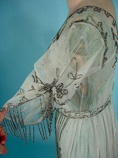 Gathered sleeve on beaded net overdress, c. 1915