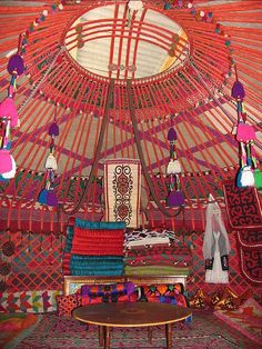 yurt interior, Kyrgyzstan: Can't you just imagine lounging around in this gorgeous abode, adorned in long strands of #Vintage #Thai Buddhas? Perhaps a golden Buddha with fiery red #Czech glass of some sparkly metals to mix up the palette? www.litanyjewelry.com