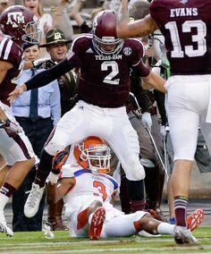 Texas A&M quarterback Johnny Manziel steps over Sam Houston State defensive back Shelby Davis. (David J. Phillip/AP)