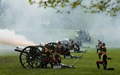 The King's Troop Royal Horse Artillery fire a 41-gun salute in Green Park to mark the arrival of the Queen  at the Houses of Parliament to deliver her speech