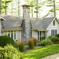 love the grey logs ... perhaps an addition or outbuildings like this?