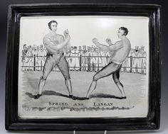 Dated: 1825 England  A rare large sized pottery plaque with integral black glazed frame depicting the historic boxing match between Spring and Langan which was held in Worcester in 1824..Spring emerged the winner. A similar example is located in the Royal Pavilion Museum in Brighton part of the Willett Collection.