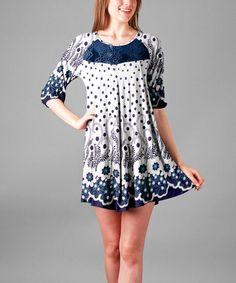 This White & Navy Floral Empire-Waist Dress is perfect! #zulilyfinds