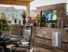Tandem® Modular Grid was used to build out this outdoor kitchen, which houses multiple cooking surfaces and outdoor appliances, as well as a built-in flatscreen TV and sound system.
