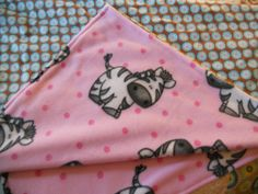 Baby blanket with cute little zebras pink background. Soft fleece fabric. Back of blanket flannel fabric by MissyCraftsandGoods on Etsy