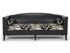 Generous style and comfort with a tailored silhouette.  It's the details - slender shelter arms, gently curved camelback and long, tapered wood legs - that give our BelAir Sofa its contemporary flair. Bolster cushions complement the pared-down profile, lending a modern and elegant 'French Deco' mood.