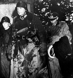 Gen. Karl-Wilhelm von Schlieben and Adm. Walter Hennecke arrive to negotiate the surrender of Cherbough with Major Gen Joseph «Lightning Joe» Lawton Collins, at the château de Servigny, Yvetot Bocage, June 26, 1944.