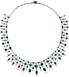Art Deco emerald and diamond fringe necklace with 49 separate fringes of Colombian emeralds and old mine cut diamonds. Via Diamonds in the Library.