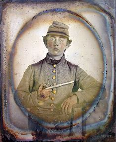 """Ca. 1861-65. """"Young soldier in Confederate shell jacket and forage cap with single shot pistol."""" Sixth-plate ambrotype, hand-colored. Liljenquist Family Collection of Civil War Photographs, Library of Congress."""