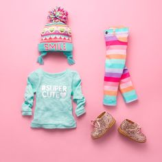 Toddler girls' fashion | Kids' clothes | Graphic top | 'Smile' pom pom beanie | Rainbow stripe jeggings | Glitter shoes | The Children's Place