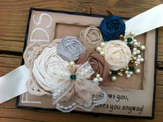 Lorena- Rosette Wedding Sash -  Ivory, Cream, Beige, Mocha and Jade... with a crocheted Doily and gold bead and pearls cluster... $73.95, via Etsy.