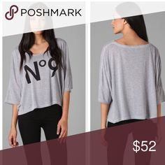 "Wildfox Raglan Tee This is a NWT Wildfox No9 raglan tee in light grey. Features include scoop neck, 3/4 sleeves, and front print text. Length is 22"". Made in the USA🇺🇸 ⚜Please see my ""reasonable offers"" listing at the top of my page before submitting an offer⚜Thank you😊 Wildfox Tops"