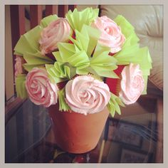 Cupcake bouquet that holds 12 cupcakes.  Flower pot and 6in. styrofoam ball needed. Use toothpicks to attach cupcakes to ball. Add green tissue paper as needed to look like leaves.