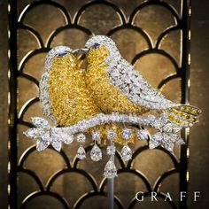 The ultimate expression of love - A statement yellow and white diamond Love Bird brooch featuring 441 yellow diamonds and incorporating a total of 46 carats of exceptional diamonds. #GraffDiamonds #LoveBirds #YellowDiamonds #FineJewellery