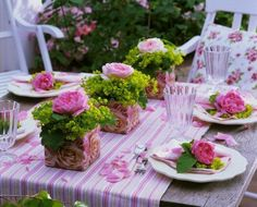Single pink flower with lots of greens....love the linens as well! Pretty!