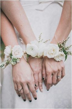 The house party will wear bracelets of ivory spray roses, blush waxflowers, and parvifolia eucalyptus on champagne ribbon to tie to the wrist.