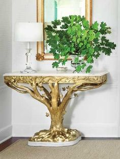 Klein conceived the entrance hall's pair of cast-bronze consoles (one is shown) in homage to the holly trees that had to be chopped down when the property's drive was rerouted.