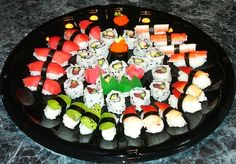 four kinds of nigiri sushi (tuna, avocado, surf clams and crab sticks), three kinds of maki sushi rolls (California roll, inside-out tuna and cucumber roll, and vegetarian roll), and 2 pieces of gunkan maki (also called battleship sushi) topped with tobiko. #sushi