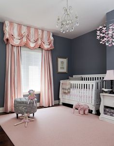 Striped drapes in pink and white enliven traditional nursery in gray [Design: Merigo Design]