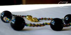 Cadenas y collares - collar hilos de colores y bolas negras - hecho a mano por CeeZed-knitting en DaWanda