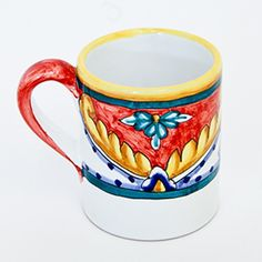 Mug with blue and yellow geometric design on red background. Click on the image to learn more about this beautiful mug!