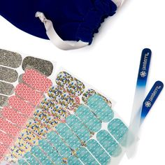 2016 Holiday Gift Set | Starting at $50.00 | Our Holiday Gift Set features a pair of our best-selling Glass Nail Files and your choice of 4 nail wraps (including exclusives only available with this set!) - so you can mix and match to create the perfect, personalized gift for everyone on your list - all wrapped in a luxe, blue velvet gift bag.