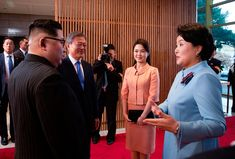 The first ladies joined Kim and Moon for a banquet at the end of the summit. At right is Moon's wife, Kim Jung-sook. Next to her is Kim's wife, Ri Sol Ju. Korea Summit Press Pool/AFP/Getty Images