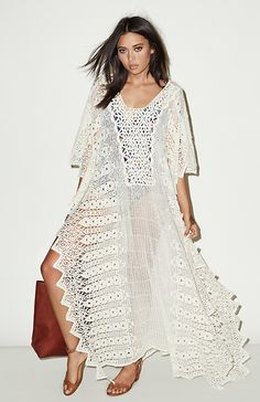 Lovely swimsuit cover up or flowy dress in white lace. Boho style perfection.