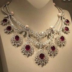 Van Cleef & Arpels necklace made of diamonds, conch beads and rubies, 2014 . Royal Jewelry, Ruby Jewelry, High Jewelry, Luxury Jewelry, Diamond Jewelry, Jewelery, Ruby And Diamond Necklace, Diamond Necklaces, Ruby Earrings