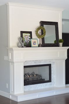 LOOOOOOVE this mantel!  I especially love the stuff on top!  :)    mantel by croskelley, via Flickr