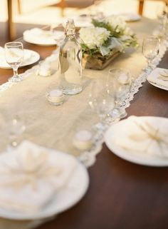 Everything I could love at a table -- Burlap, lace, swing top bottles, and eco-friendly potato utensils!!