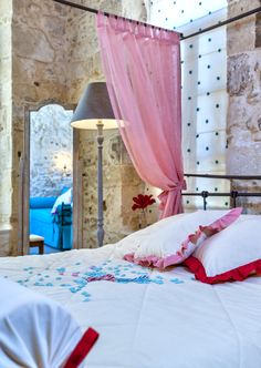 CANDY made from sugar and natural colours, offers a wide variety of shapes, scents, flavors and features a magnificent suite with great personality, explosive colors, a canopy bed and small balcony with views of the old city.