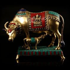 Brass & Mosaic Cow With Calf   http://www.indiancraftsmen.com/home-decor/brass-amp-mosaic/brass-and-mosaic-cow-with-calf