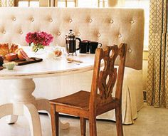 Banquette seating: love the round table and combo of cozy and vintage.