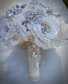 Custom made wedding bridal brooch bouquets, rhinestone wedding bouquets, and heirloom wedding brooch bouquets for sale at http://glambouquet.com