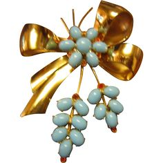Coro made this beautiful vermeil sterling bow brooch with turquoise glass flower in the center of the bow and two leaves with the same turquoise