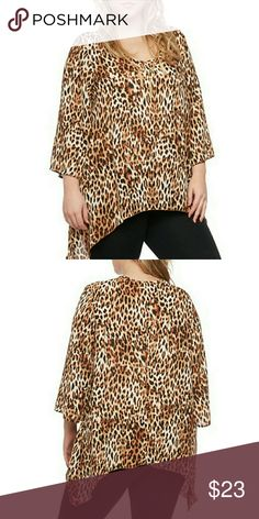 Leopard top NWT Plus size leopard print top goes well with black leggings or jeans,3/4 sleeves scoop neck full lenght is 36 inches,sleeve lenght is 52 inches. Measurements: chest 40 waist 34 and hips 44 inches. Tops