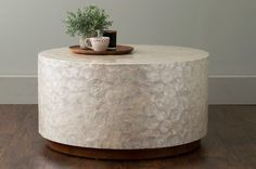 East at Main Rowden Off-White Wood and Capiz Round Coffee Table, For Sale Beach Style Coffee Tables, Cool Coffee Tables, Decorating Coffee Tables, White Round Coffee Table, Silver Coffee Table, White Coffee, Drum Coffee Table, Round Chair, Living Room Remodel